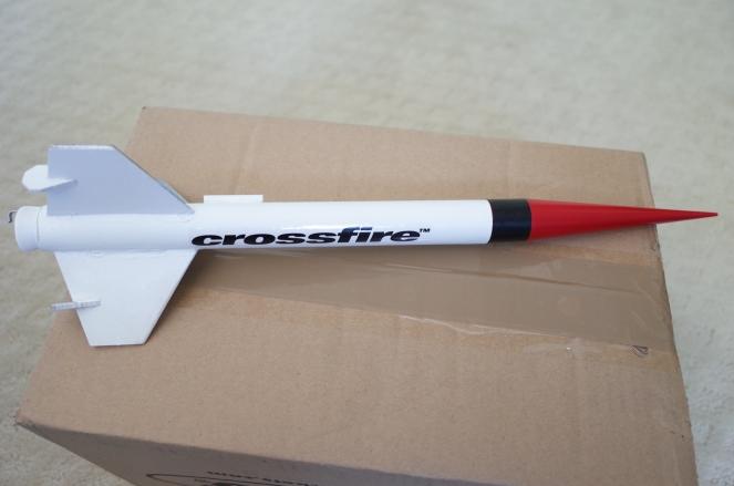 Crossfire rocket sitting on a cardboard box