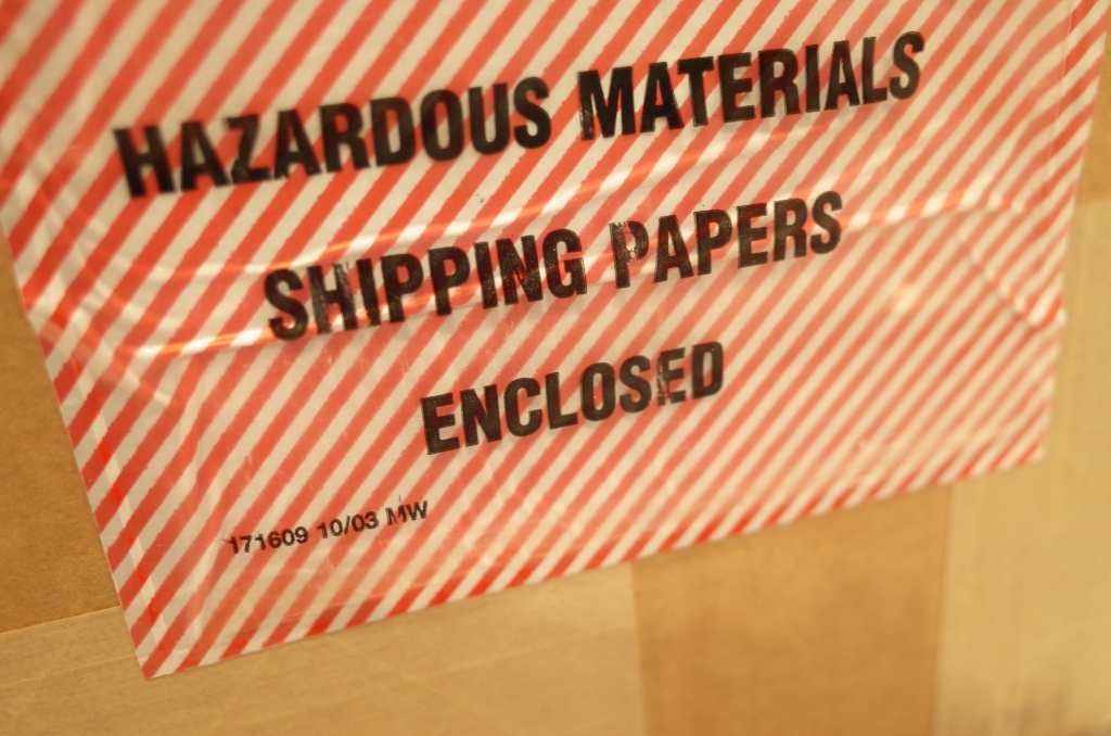 "Shipping label on box: ""Hazardous materials"""