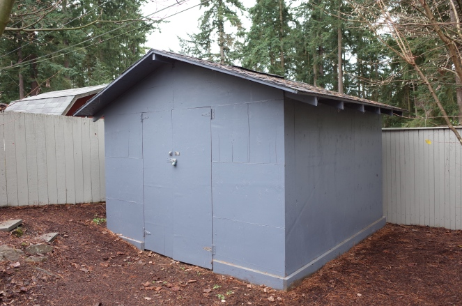 Simple blue garden shed