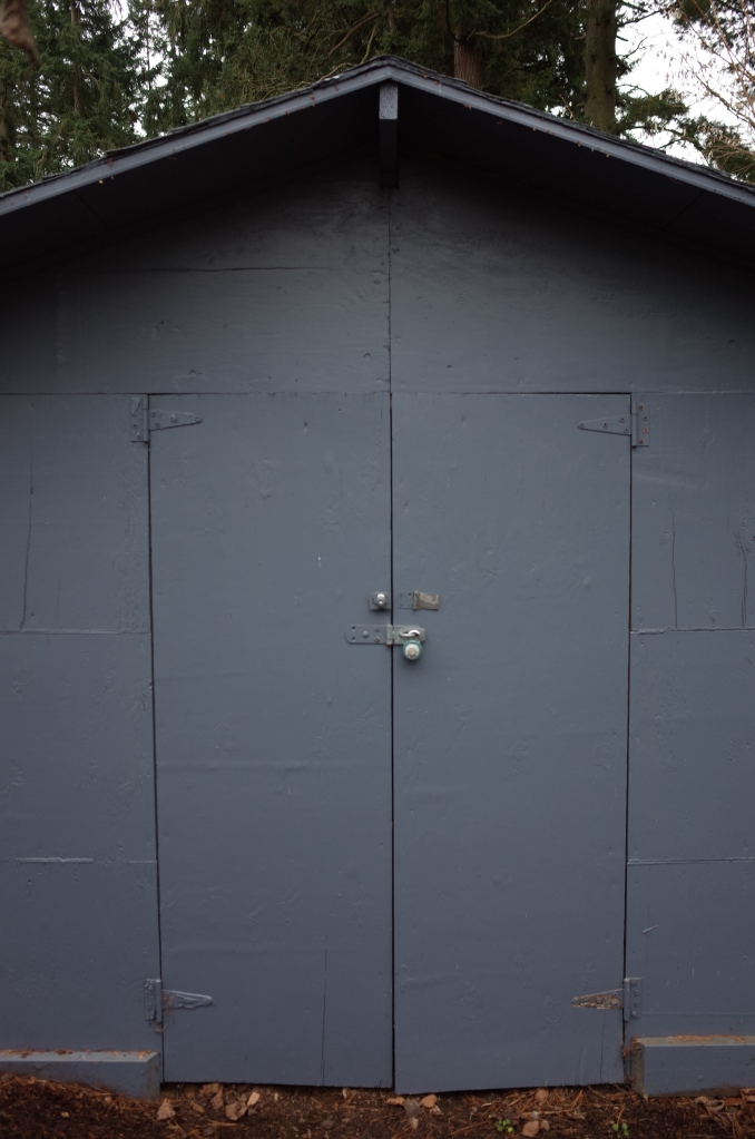 Double doors on shed, made of plywood, with padlock