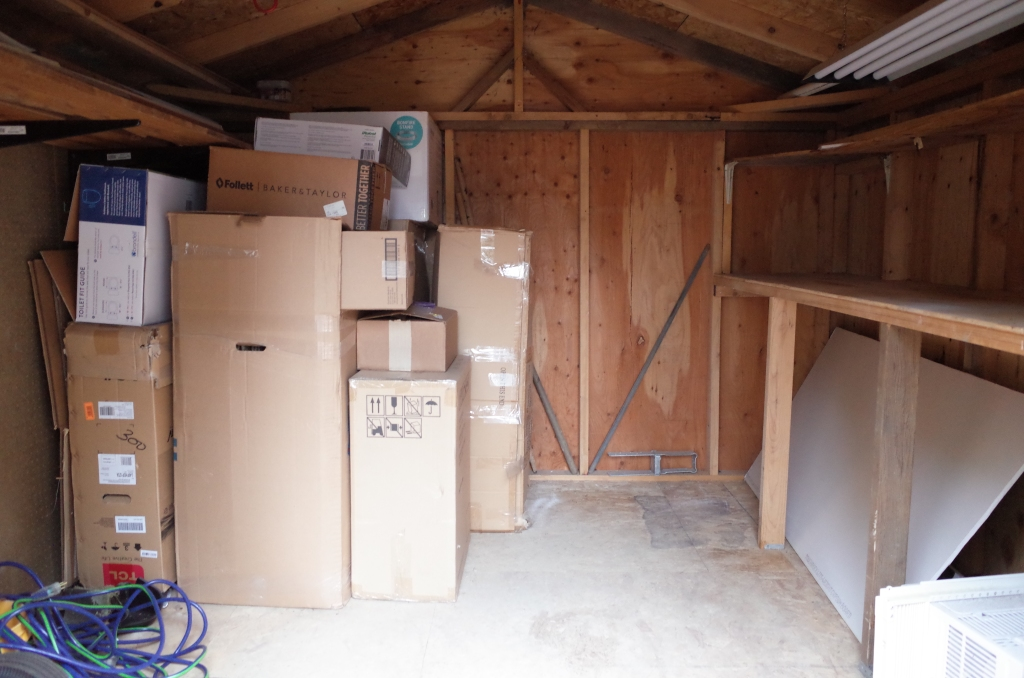 Inside view of shed with plenty of junk