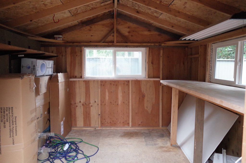 View of shed interior with new window in rear wall
