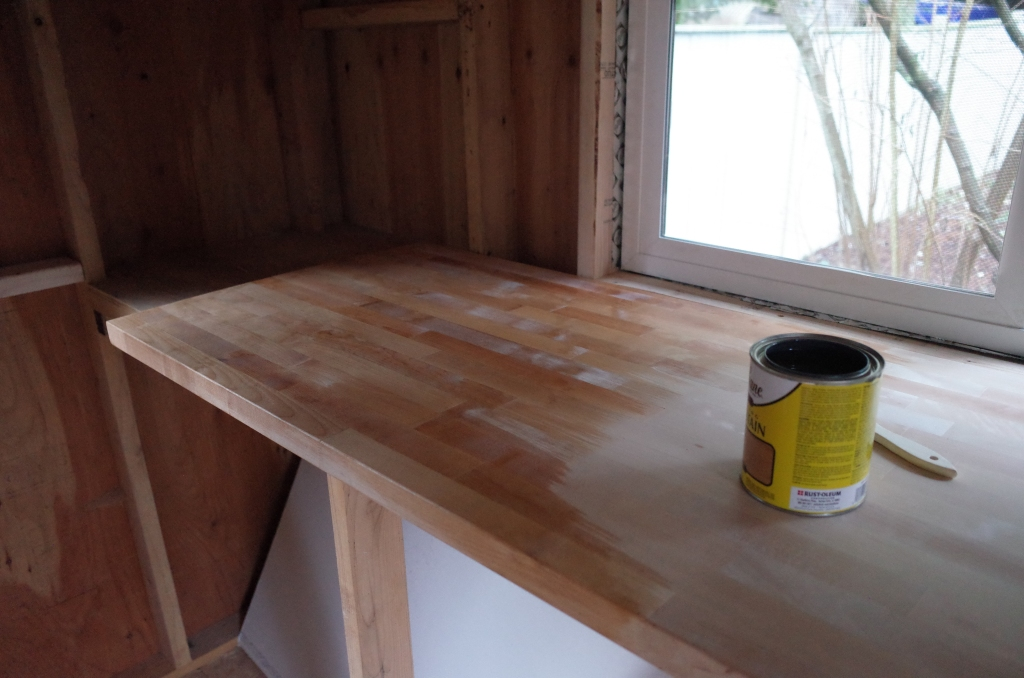 Applying wood stain to butcher block