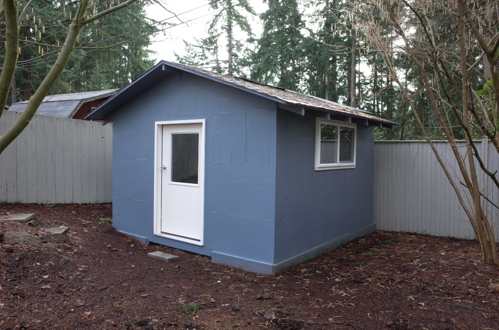 Newly painted blue shed, front and side view