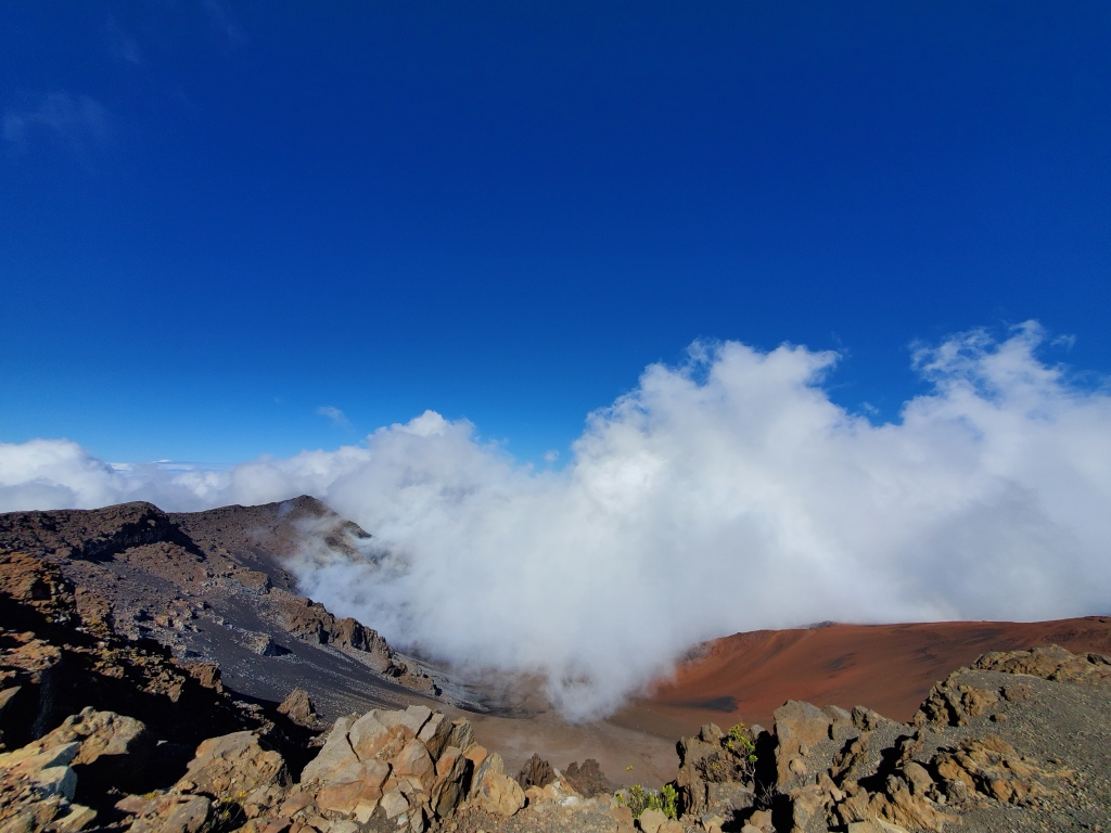 view of haleakala crater from the summit, obscured by clouds