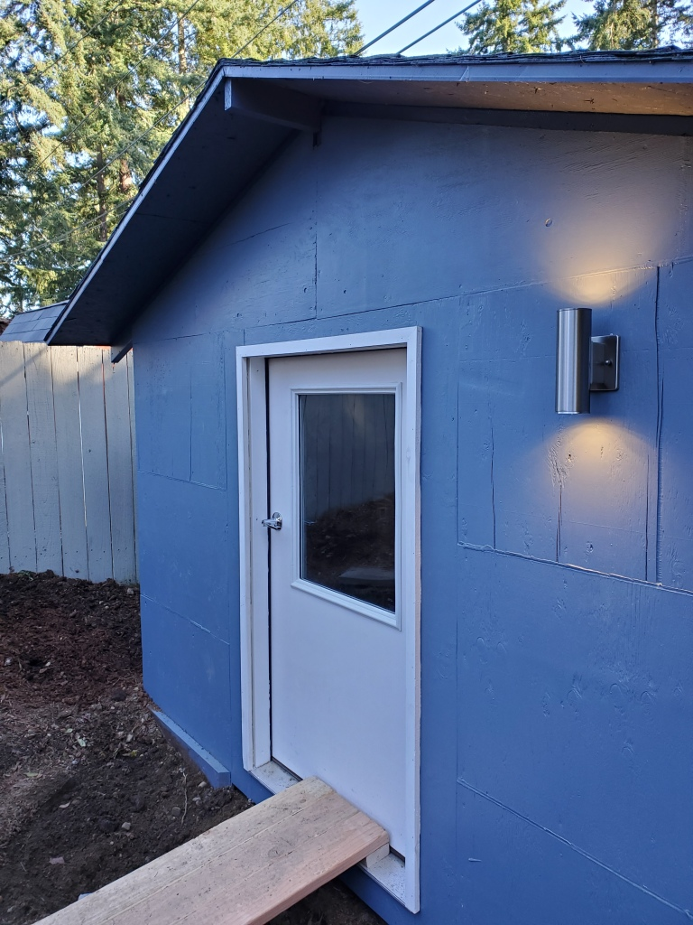 front of shed with door and new exterior light
