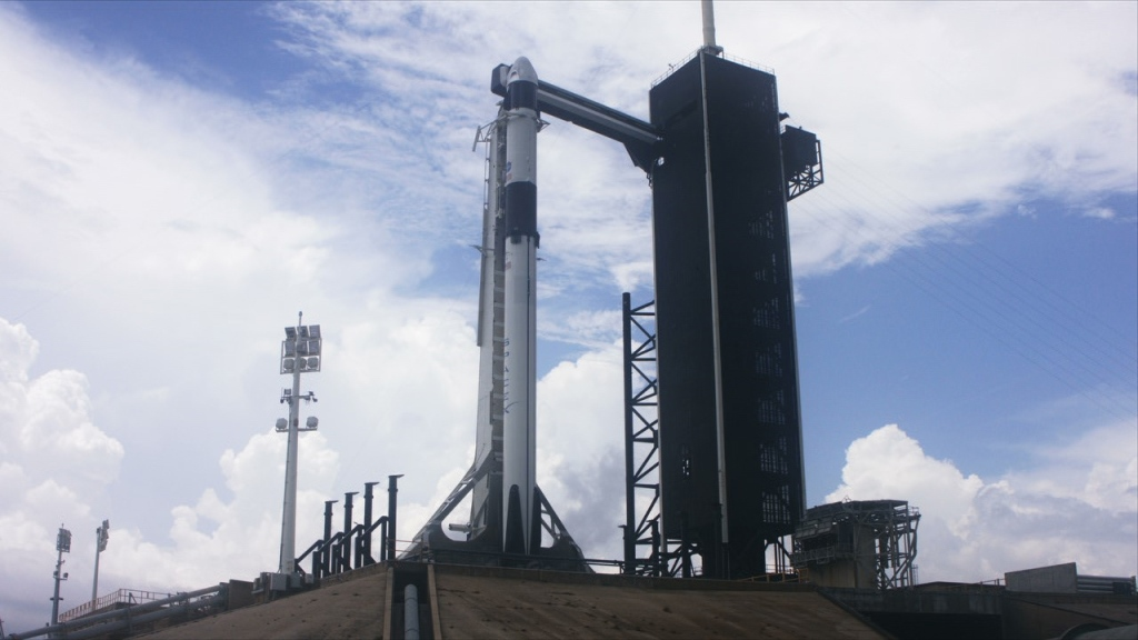 spacex falcon 9 rocket and crew dragon vehicle on launch pad
