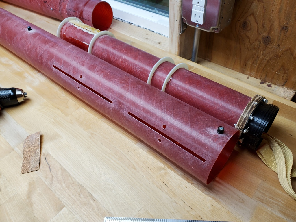 further back view of red rocket body with two rail buttons secured