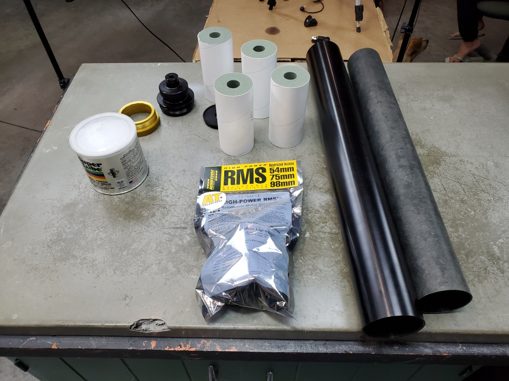 Rocket motor parts on table, before assembly
