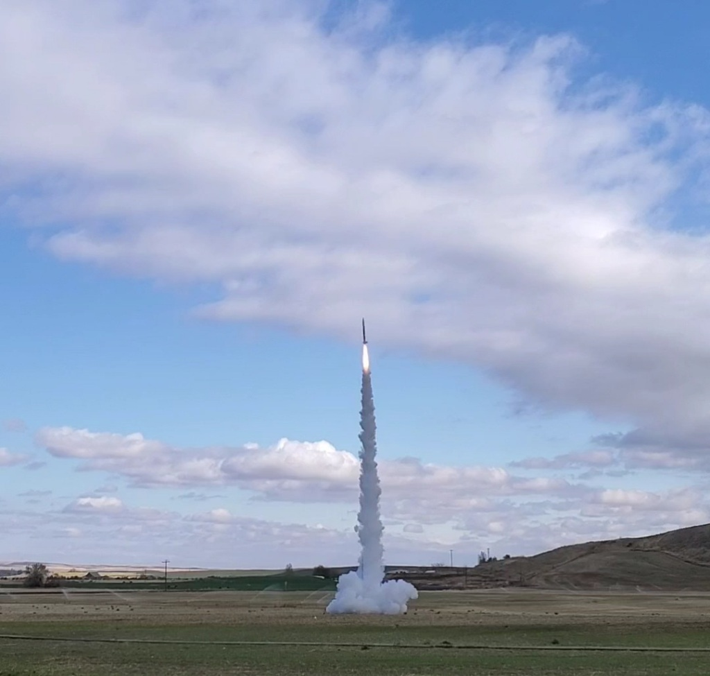 rocket launching with cloud of smoke underneath