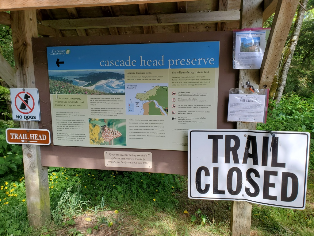 trailhead sign stating trail is closed