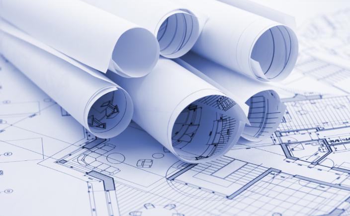 rolled up paper blueprints
